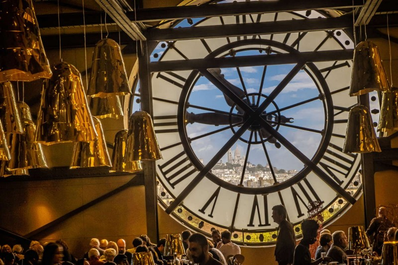 Shot from within the restaurant of the Museé d'Orsay in Paris, looking at Montmartre. As it was lunch time, it was very crowded and I had to shoot the photo handheld, while people were passing all around me. In post-shooting I had to treat the area  within the circle of the clock quick differently from the interior of the restaurant.